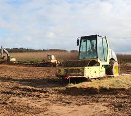 Gewerblicher Grundstückshandel bei Errichtung eines Erweiterungsbaus